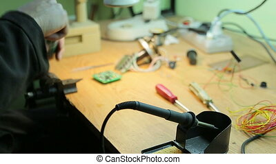 Job soldering - Scientist working soldering iron
