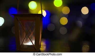 Outdoor lantern with lit candle