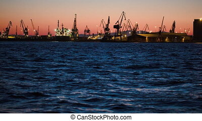 Illuminated dock in late evening - Panorama of illuminated...