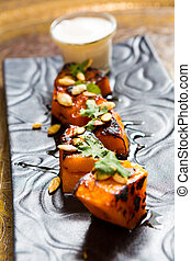 Grilled pineapple - pineapple slices grilled. served with...