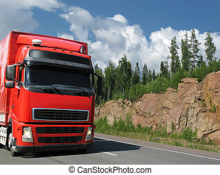red truck on rocky highway