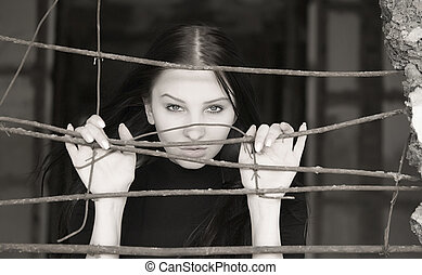 pretty woman - young pretty woman behind iron grid