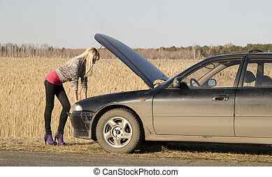 broken car - young pretty blonde with her broken car