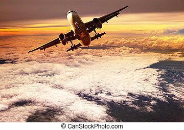 passenger jet plane take off to mid air against beautiful golden