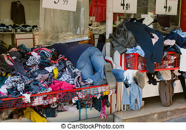 Second hand clothes - A man searching something in a second...