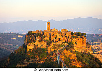 Civita di Bagnoregio landmark, aerial panoramic view on sunset.
