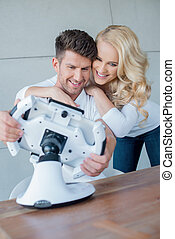 Sweet Young Couple Having Fun with Cool Gadget - Happy Sweet...