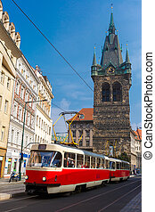 Red retro tram near Jindrisska Tower in Prague, Czech