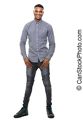Full length portrait of a cool black guy smiling on isolated...