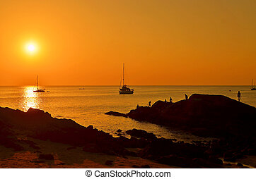 Boat and sunset beach
