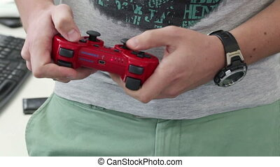 Joystick consoles - Wireless remote gaming consoles in hand...