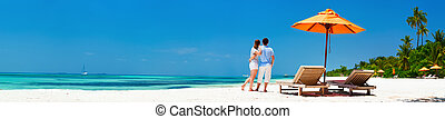 Couple at tropical beach - Romantic couple on a tropical...