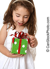 Little girl with a christmas or other present