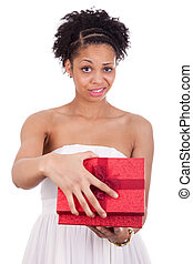 Disappointed young African American woman opening a gift box