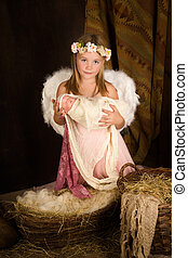 Pink Christmas angel girl - Pink little girl playing an...