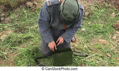 The soldier puts machine-gun tape in a drawer. The first world war.WWI.