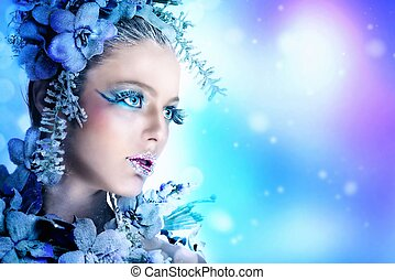 Winter makeup of a beautiful woman portrait