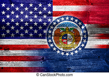 USA and Missouri State Flag painted on old wood plank...