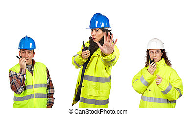 Construction workers talking with a walkie talkie - Three...