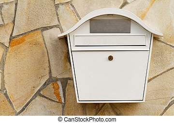 Letter box - Photo of a white mailbox on the wall