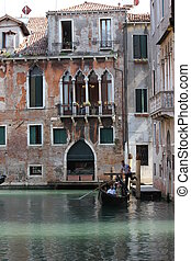 Venice Gondolier floating on a traditional venetian canal....