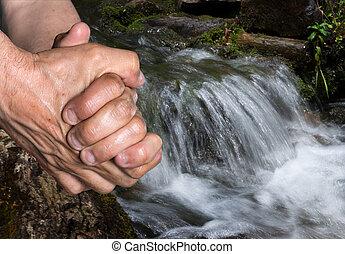 elderly man washes his hands