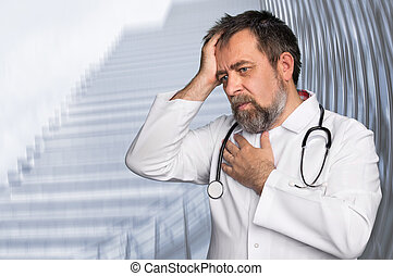 Thoughtful doctor. Portrait of a doctor with stethoscope