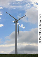 Wind turbine to generate electricity with blue sky in the...