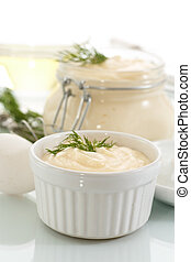 mayonnaise - cooked homemade mayonnaise with food on a white...