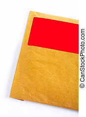 Detail of envelope with blank red sticker, isolated on white...