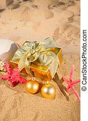 christmas gifts on beach - christmas golden gift with...