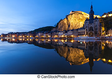 Cityscape of Dinant at night along the river Meuse, Belgium