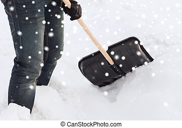 closeup of man digging snow with shovel - transportation,...