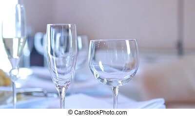 Three wine glasses on table - passing of chamber along a...
