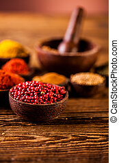 Spices in Indonesian wooden bowls - Traditional oriental...