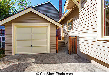 House and garage in clapboard siding trim - House exterior...