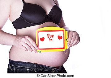 Pregnant Sign Due in - pregnant woman clothed in black bra...