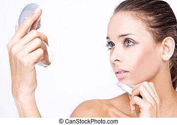 Beautiful woman applying lipstick - Makeup - Beautiful woman...