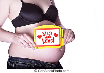 Pregnant Sign With Love - pregnant woman clothed in black...