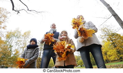 happy family playing with autumn leaves in park - family,...