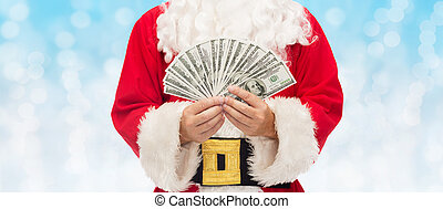 close up of santa claus with dollar money - christmas,...