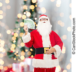 man in costume of santa claus with euro money - christmas,...