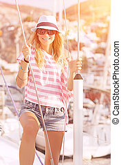 Luxury photoshoot on sailboat, cute blond model posing in...