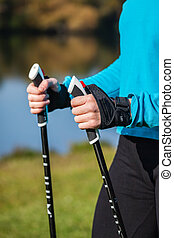 Closeup of womans hand with nordic walking poles - Nordic...