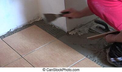 floor tiling worker