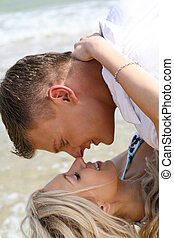 Making love together at the beach