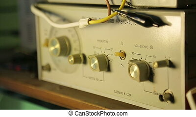Low-frequency signal generator, a scientist controls,...