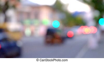 Cars in motion blur on the street .