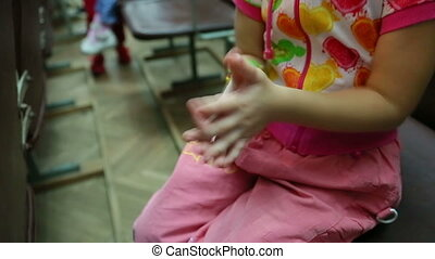 Little girl claps her hands to the childrens festival