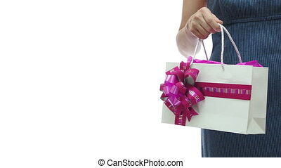 Woman Pink Gift Bag Copyspace - An anonymous woman in a blue...